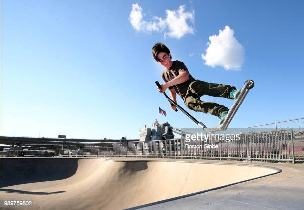 Declan McEnerney of Boston gets some air with his scooter at the Lynch Family Skatepark in Cambridge MA on June 29 2018