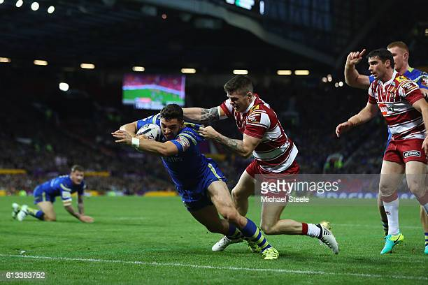 Declan Patton of Warrington scores the opening try despite the challenge from John Bateman of Wigan during the First Utility Super League Final...