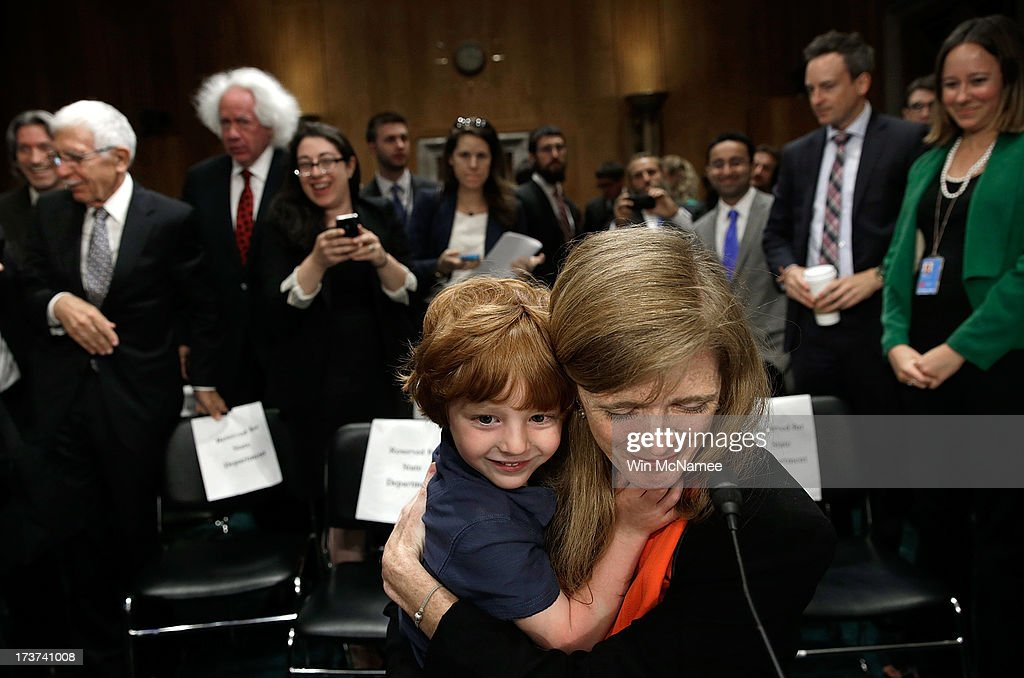 Declan Power Sunstein hugs his mother, Samantha Power, the nominee to be the U.S. representative to the United Nations, at the conclusion of her testimony before the Senate Foreign Relations Committee July 17, 2013 in Washington, DC. Power has received broad bipartisan support for her nomination.