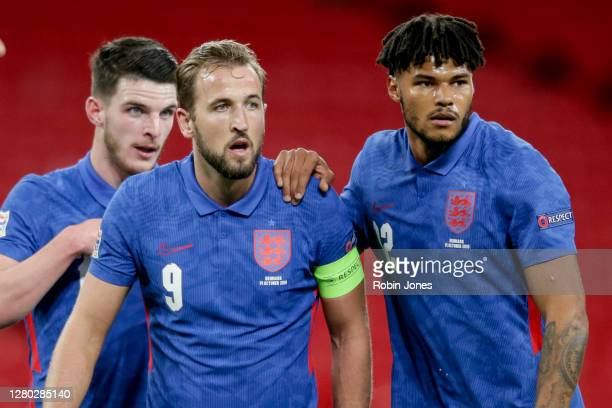 Declan Rice, Harry Kane and Tyrone Mings of England during the UEFA Nations League group stage match between England and Denmark at Wembley Stadium...