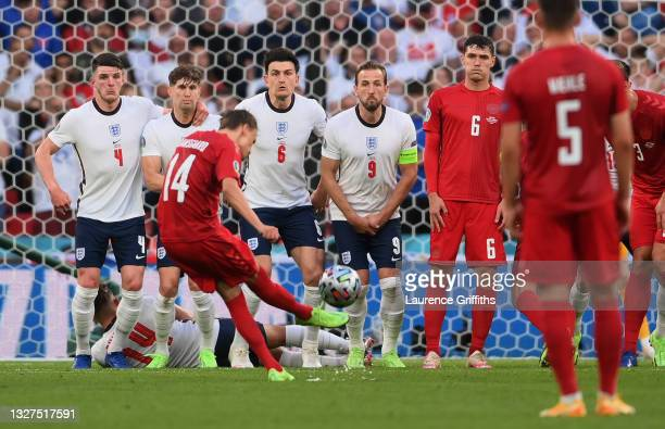 Declan Rice, John Stones, Harry Maguire and Harry Kane of England fail to stop a goal scored by Mikkel Damsgaard of Denmark from a free kick during...