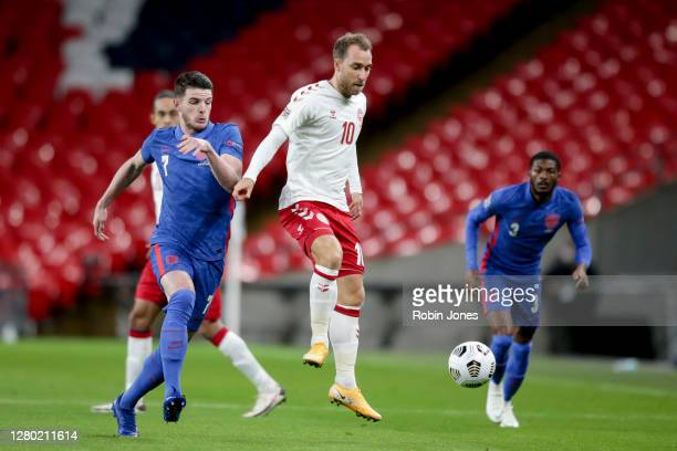 Declan Rice of England and Christian Eriksen of Denmark during the UEFA Nations League group stage match between England and Denmark at Wembley...
