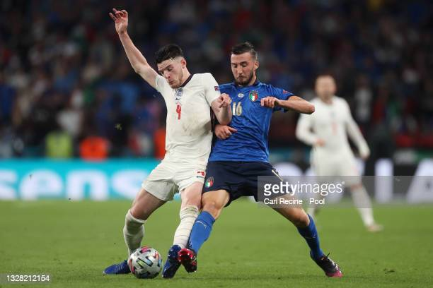 Declan Rice of England battles for possession with Bryan Cristante of Italy during the UEFA Euro 2020 Championship Final between Italy and England at...