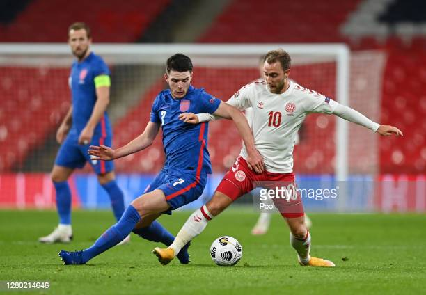 Declan Rice of England battles for possession with Christian Eriksen of Denmark during the UEFA Nations League group stage match between England and...