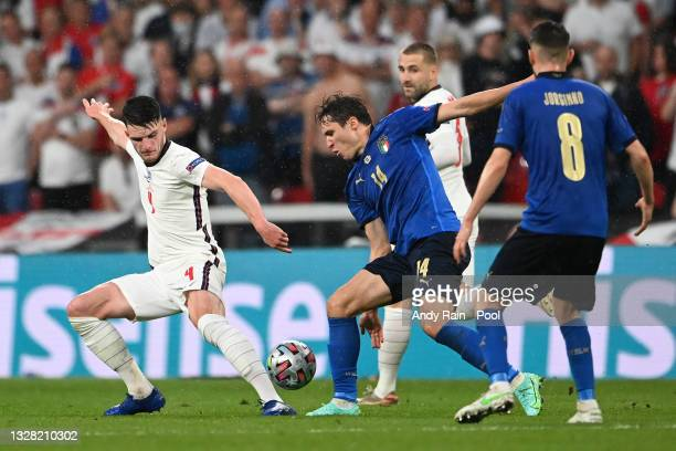 Declan Rice of England battles for possession with Federico Chiesa of Italy during the UEFA Euro 2020 Championship Final between Italy and England at...