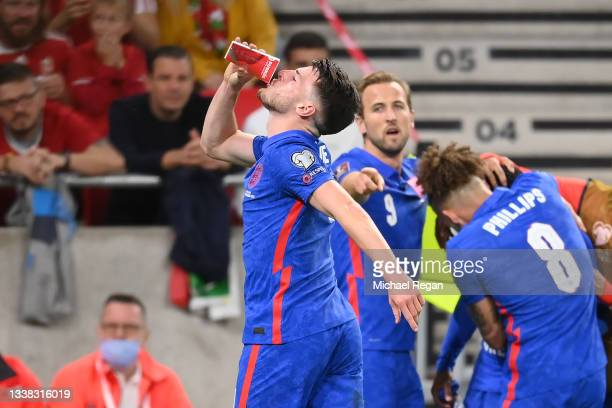 Declan Rice of England celebrates the first goal by drinking from a cup thrown by the crowd during the 2022 FIFA World Cup Qualifier between Hungary...