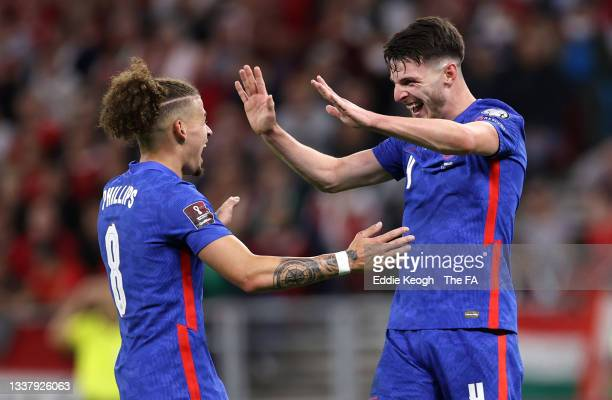 Declan Rice of England celebrates with Kalvin Phillips after scoring their team's fourth goal during the 2022 FIFA World Cup Qualifier match between...
