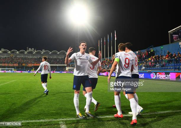 Declan Rice of England celebrates with team mates as Michael Keane scores his team's first goal during the 2020 UEFA European Championships Group A...