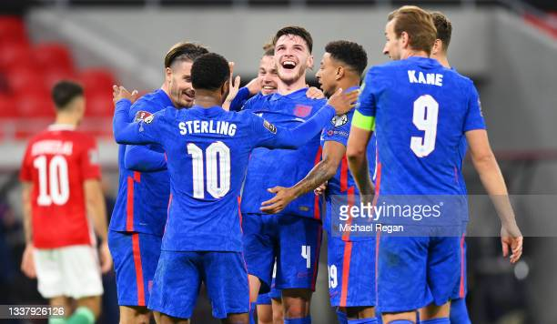 Declan Rice of England celebrates with teammates after scoring their team's fourth goal during the 2022 FIFA World Cup Qualifier match between...