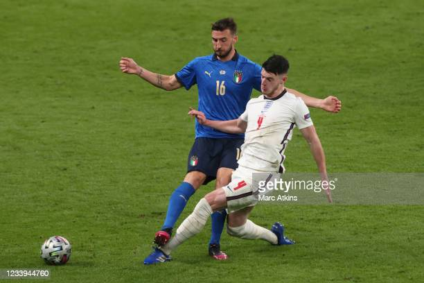 Declan Rice of England in action with Bryan Cristante of Italy during the UEFA Euro 2020 Championship Final between Italy and England at Wembley...