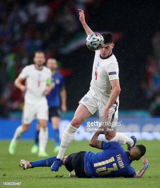Declan Rice of England is brought down by Emerson of Italy during the UEFA Euro 2020 Championship Final between Italy and England at Wembley Stadium...