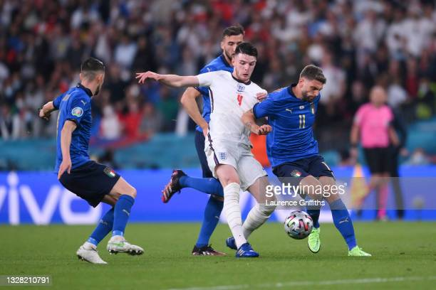 Declan Rice of England is challenged by Bryan Cristante and Domenico Berardi of Italy during the UEFA Euro 2020 Championship Final between Italy and...