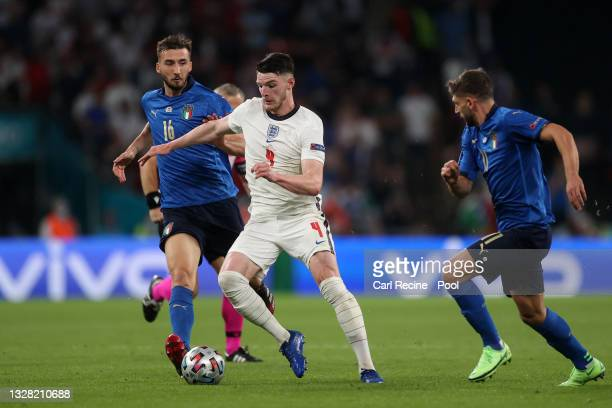 Declan Rice of England is challenged by Bryan Cristante of Italy during the UEFA Euro 2020 Championship Final between Italy and England at Wembley...