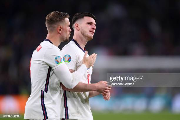 Declan Rice of England is consoled by teammate Jordan Henderson following the UEFA Euro 2020 Championship Final between Italy and England at Wembley...