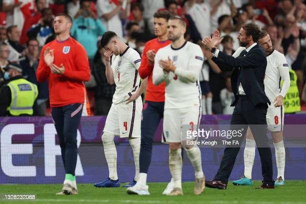 Declan Rice of England is seen in tears as Gareth Southgate, Head Coach of England applauds fans after the UEFA Euro 2020 Championship Final between...