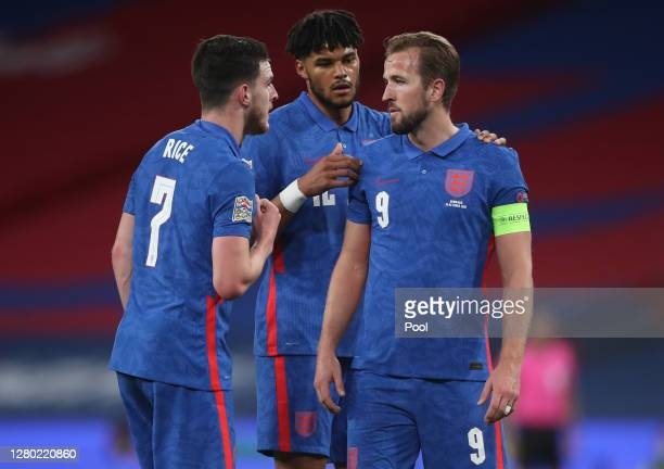 Declan Rice of England speaks with Tyrone Mings of England and Harry Kane of England during the UEFA Nations League group stage match between England...