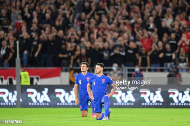 Declan Rice of England takes a knee in support of the Black Lives Matter anti-racism movement during the 2022 FIFA World Cup Qualifier match between...