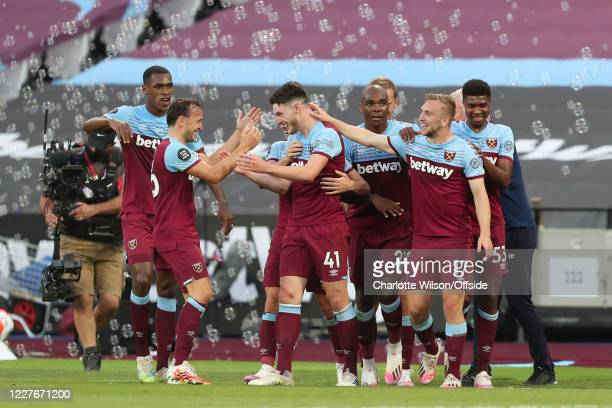 Declan Rice of West Ham celebrates after scoring their 3rd goal during the Premier League match between West Ham United and Watford FC at London...