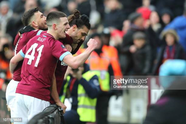 Declan Rice of West Ham celebrates their 2nd goal with goalscorer Andy Carroll of West Ham during the FA Cup Third Round match between West Ham...