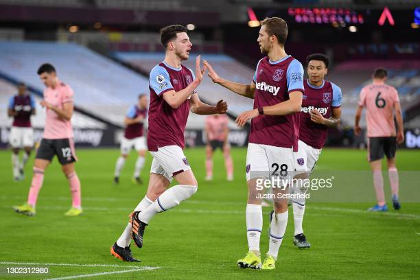 Declan Rice of West Ham celebrates with teammate Tomas Soucek after scoring their team's first goal during the Premier League match between West Ham...