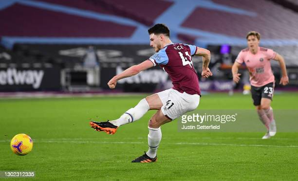 Declan Rice of West Ham scores their team's first goal from the penalty spot during the Premier League match between West Ham United and Sheffield...