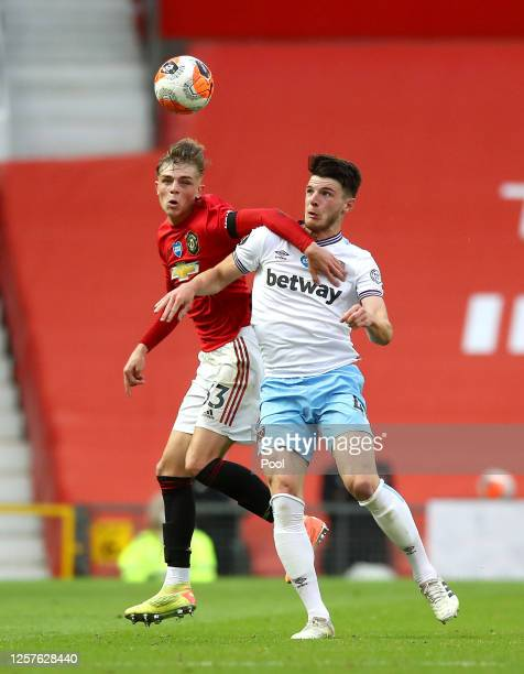 Declan Rice of West Ham United and Brandon Williams of Manchester United battle for the ball during the Premier League match between Manchester...