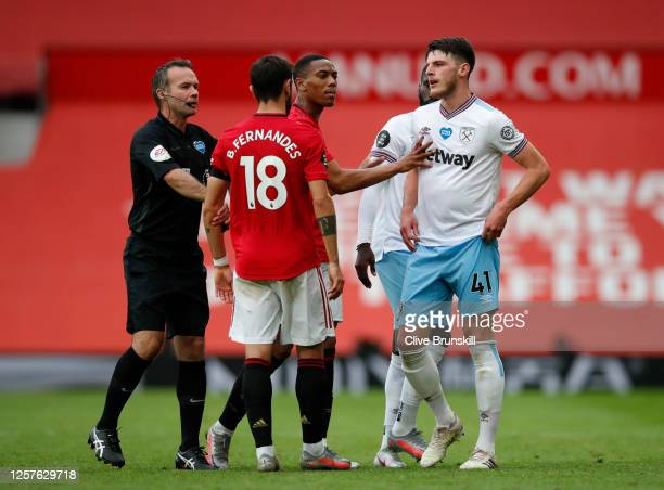 Declan Rice of West Ham United and Bruno Fernandes of Manchester United speak during the Premier League match between Manchester United and West Ham...
