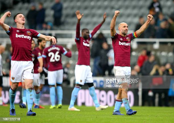Declan Rice of West Ham United and Pablo Zabaleta of West Ham United celebrate victory following the Premier League match between Newcastle United...