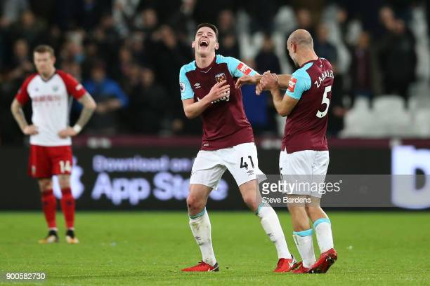 Declan Rice of West Ham United and Pablo Zabaleta of West Ham United celebrate after the Premier League match between West Ham United and West...