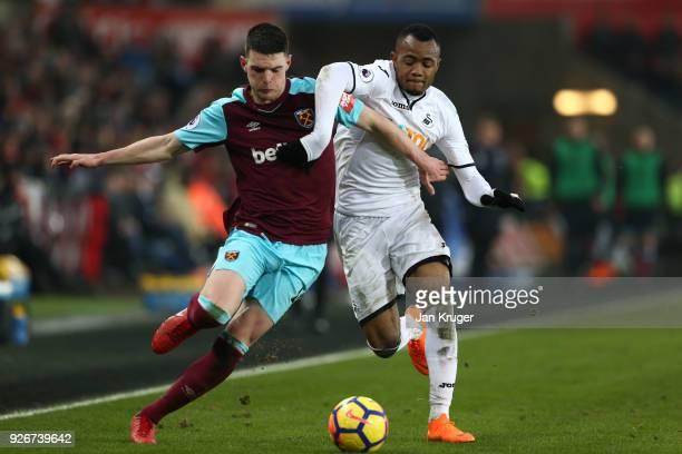 Declan Rice of West Ham United battles for possesion with Jordan Ayew of Swansea City during the Premier League match between Swansea City and West...