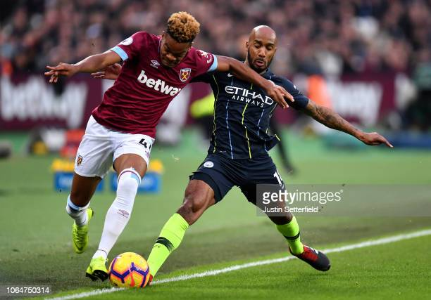 Declan Rice of West Ham United battles for possession with Fabian Delph of Manchester City during the Premier League match between West Ham United...