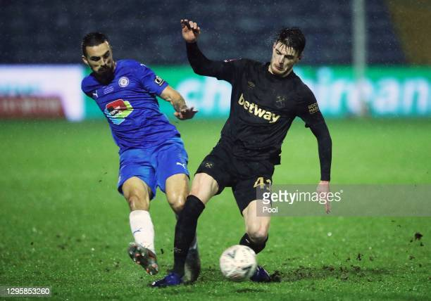 Declan Rice of West Ham United battles for possession with Jordan Williams of Stockport County during the FA Cup Third Round match between Stockport...