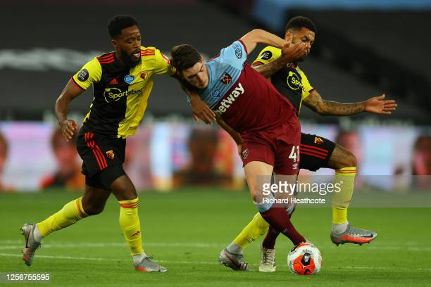 Declan Rice of West Ham United battles for possession with Nathaniel Chalobah of Watford and Andre Gray of Watford during the Premier League match...