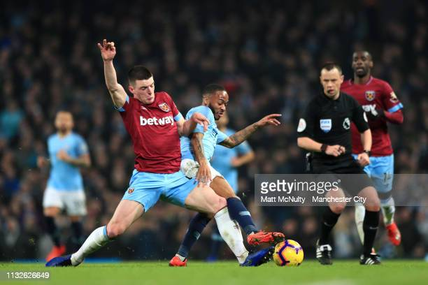 Declan Rice of West Ham United battles for possession with Raheem Sterling of Manchester City during the Premier League match between Manchester City...
