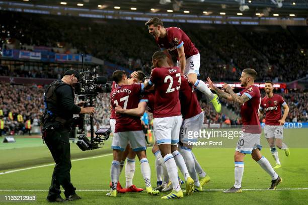 Declan Rice of West Ham United celebrates after scoring his team's first goal with his team mates during the Premier League match between West Ham...