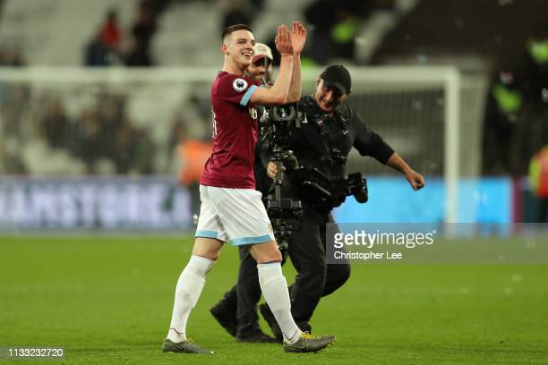 Declan Rice of West Ham United celebrates following the Premier League match between West Ham United and Newcastle United at London Stadium on March...