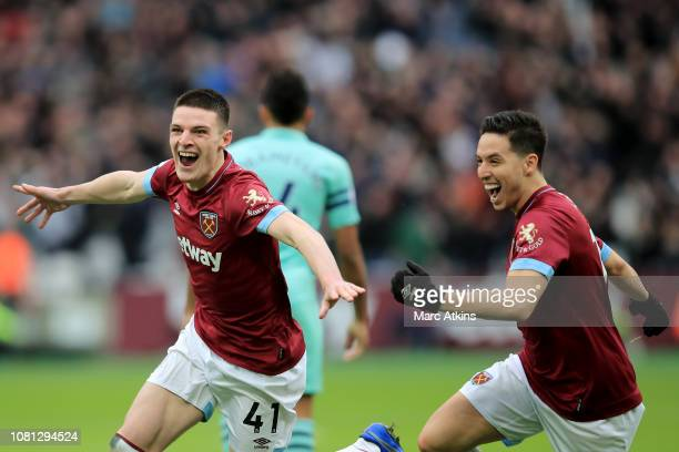 Declan Rice of West Ham United celebrates scoring the winning goal with Samir Nasri during the Premier League match between West Ham United and...