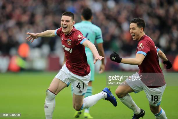 Declan Rice of West Ham United celebrates with his team mate Samir Nasri of West Ham United after scoring their team's first goal during the Premier...