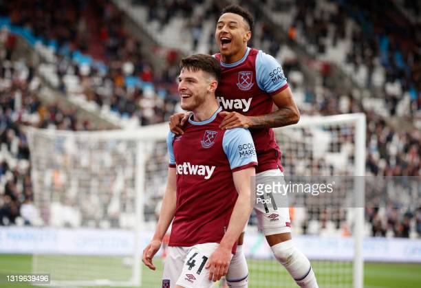 Declan Rice of West Ham United celebrates with team mate Jesse Lingard after scoring his team's third goal during the Premier League match between...