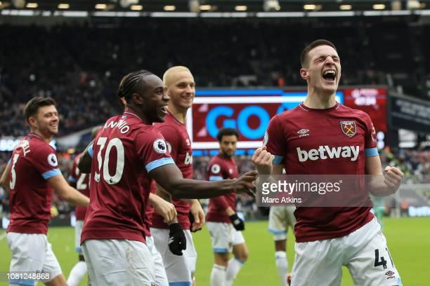 Declan Rice of West Ham United celebrates with team mates Michail Antonio of West Ham United and Marko Arnautovic of West Ham United after scoring...