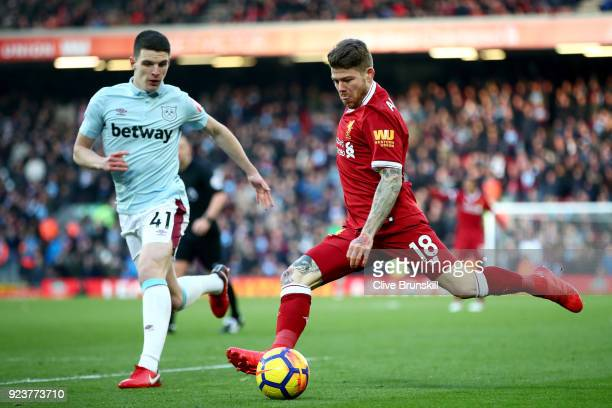 Declan Rice of West Ham United chases down Alberto Moreno of Liverpool as he takes a shot during the Premier League match between Liverpool and West...