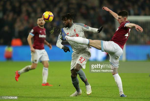 Declan Rice of West Ham United clears the ball from Divock Origi of Liverpool during the Premier League match between West Ham United and Liverpool...