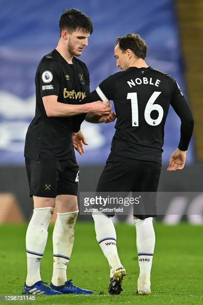 Declan Rice of West Ham United gives the captains arm band to Mark Noble of West Ham United during the Premier League match between Crystal Palace...