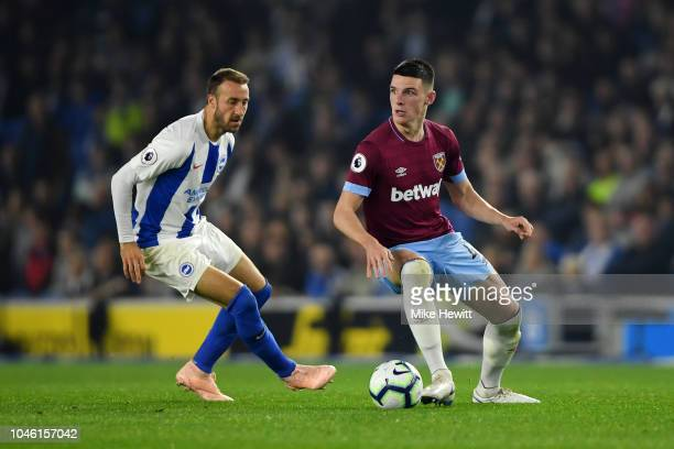 Declan Rice of West Ham United is challanged by Glenn Murray of Brighton and Hove Albion during the Premier League match between Brighton Hove Albion...