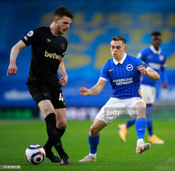 Declan Rice of West Ham United is challenged by Leandro Trossard of Brighton and Hove Albion during the Premier League match between Brighton & Hove...