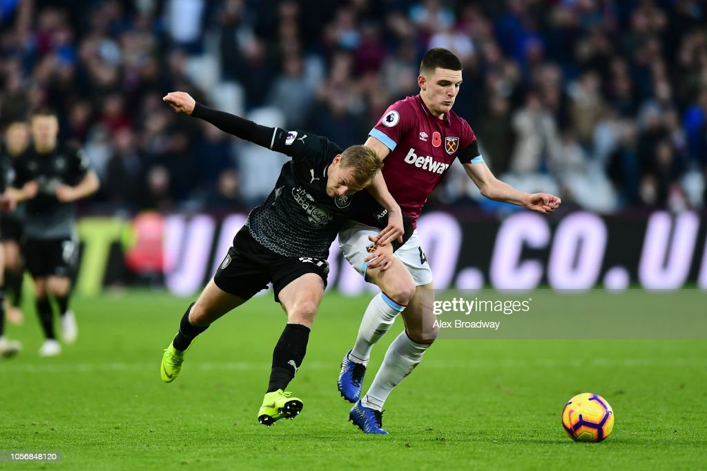 Declan Rice Of West Ham United Is Challenged By Matej