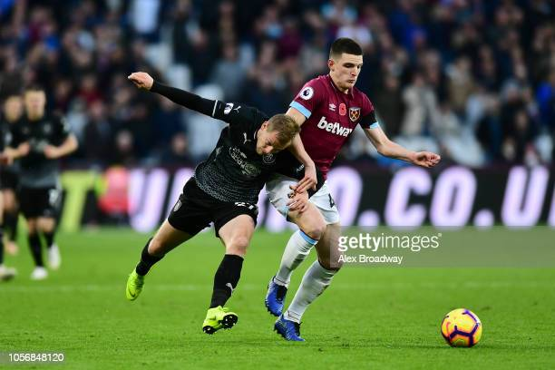 Declan Rice of West Ham United is challenged by Matej Vydra of Burnley during the Premier League match between West Ham United and Burnley FC at...
