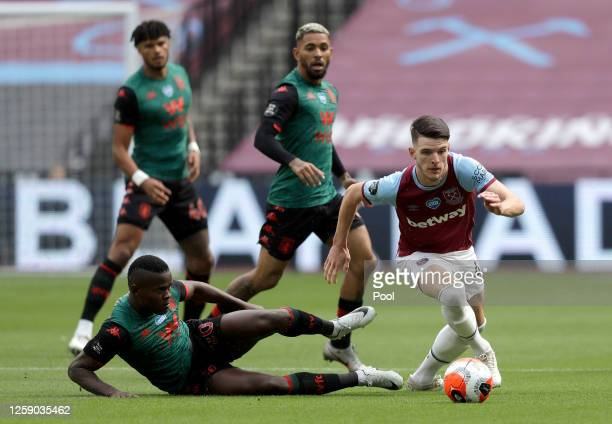 Declan Rice of West Ham United is tackled by Mbwana Samatta of Aston Villa during the Premier League match between West Ham United and Aston Villa at...