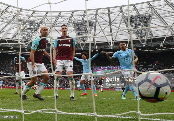 Declan Rice of West Ham United reacts to scoring a own goal for Manchester City's second goal of the game during the Premier League match between...