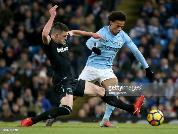 Declan Rice of West Ham United tackles Leroy Sane of Manchester City during the Premier League match between Manchester City and West Ham United at...